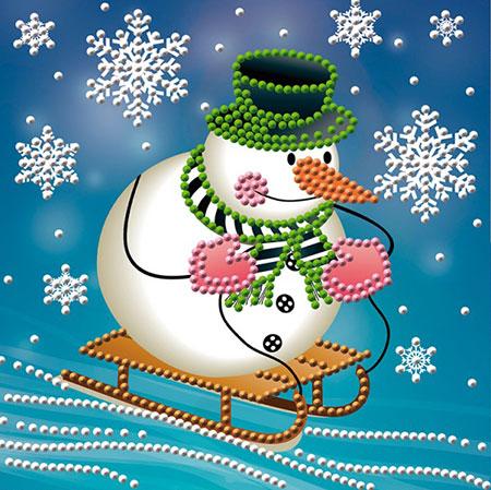 Schneemann auf dem Schlitten